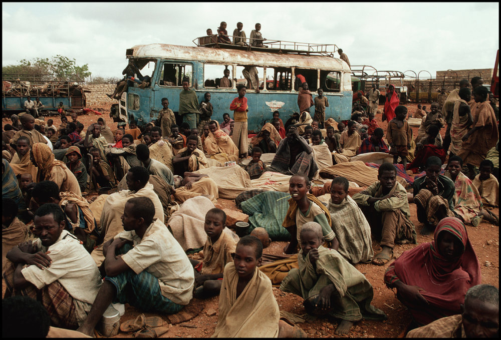 August 1992, Baidoa, Somalia --- Starved famine and war victims wait for food at a relief center