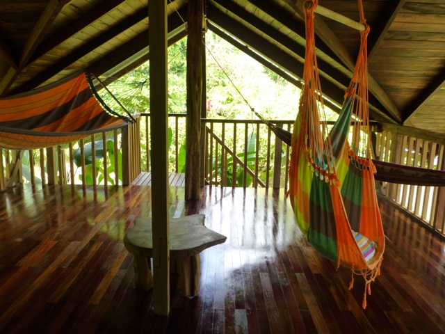Spacious 2nd-floor wooden hammock and yoga deck surrounded by verdant, unspoilt nature.