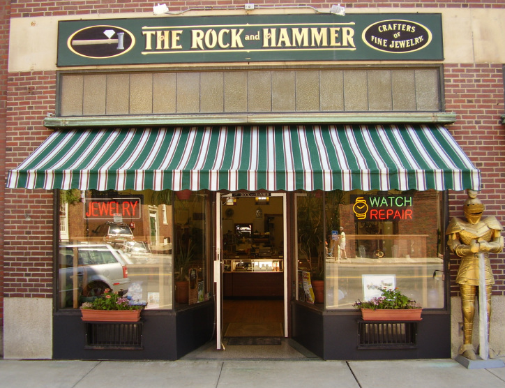 The Rock and Hammer has been a Hotel Windham anchor tenant on the Bellows Falls Square since 1989, offering traditional as well as unique, hand crafted jewelry, much of which is created on site with precious and semi-precious metals, gemstones, pearls and other materials. The Rock and Hammer specializes in custom design.    Rock and Hammer provides onsite jewelry and watch repair. Its store also carries hand crafted gift items including pottery, pewter, wooden boxes and more.     http://www.therockandhammer.com/
