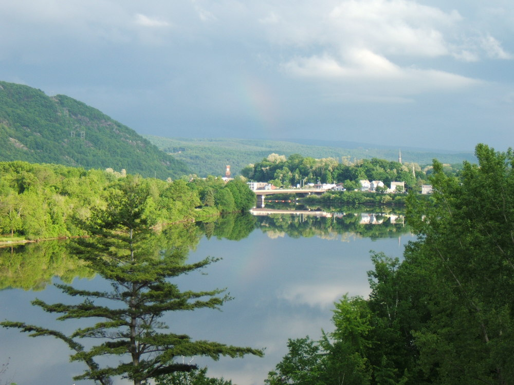 Looking south, down the Connecticut River, to the historic village of Bellows Falls, Vermont.