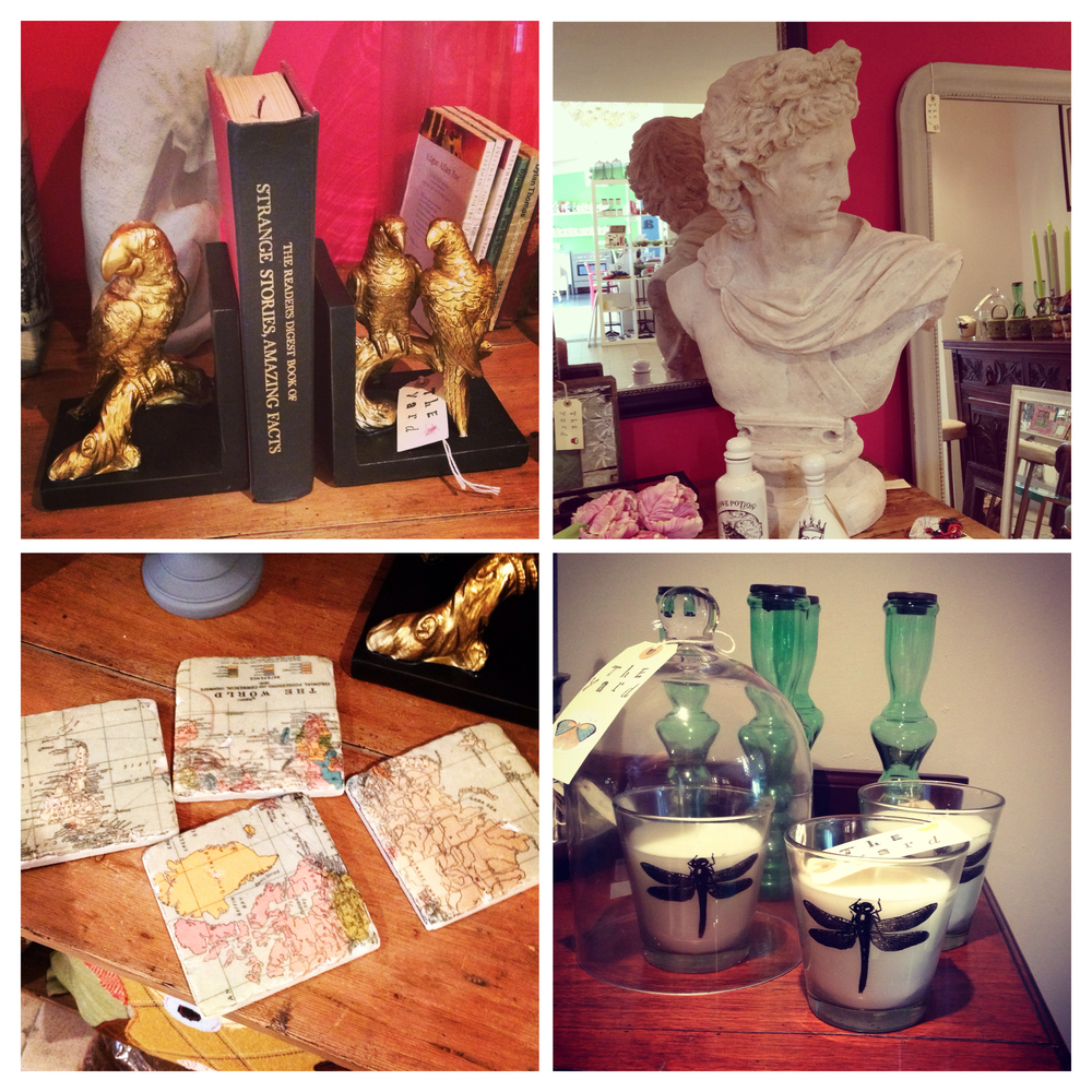 Gold parrot bookends, large Caesar bust, ceramic world map coasters and glass dragonfly candles.