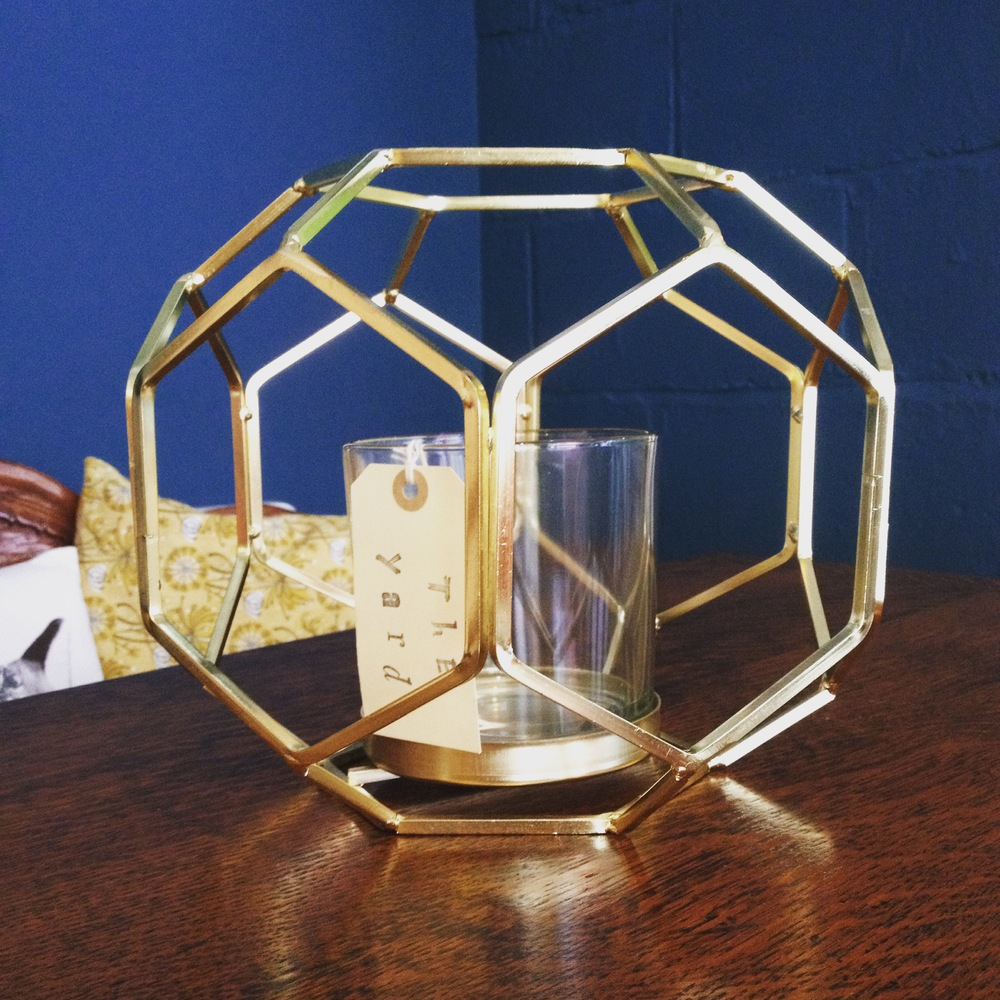 Hexagonal gold and glass lantern