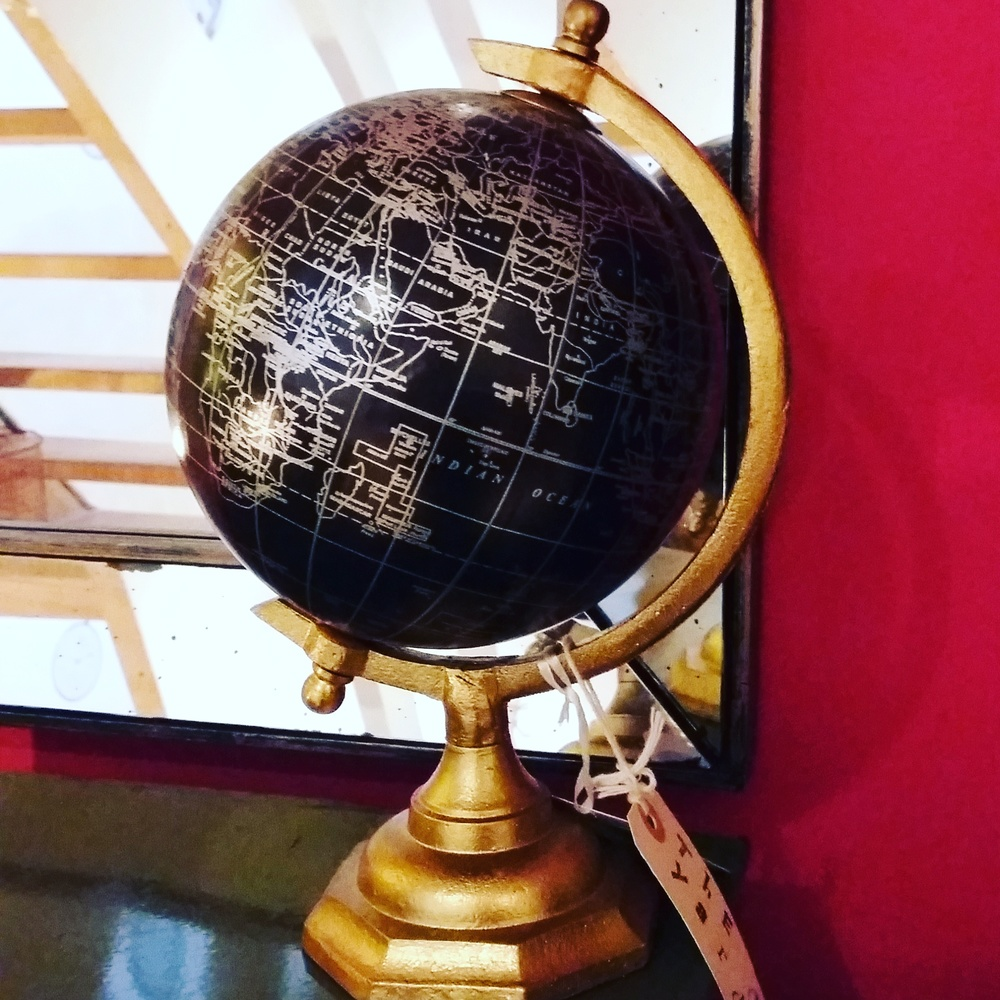 Small black and gold globe
