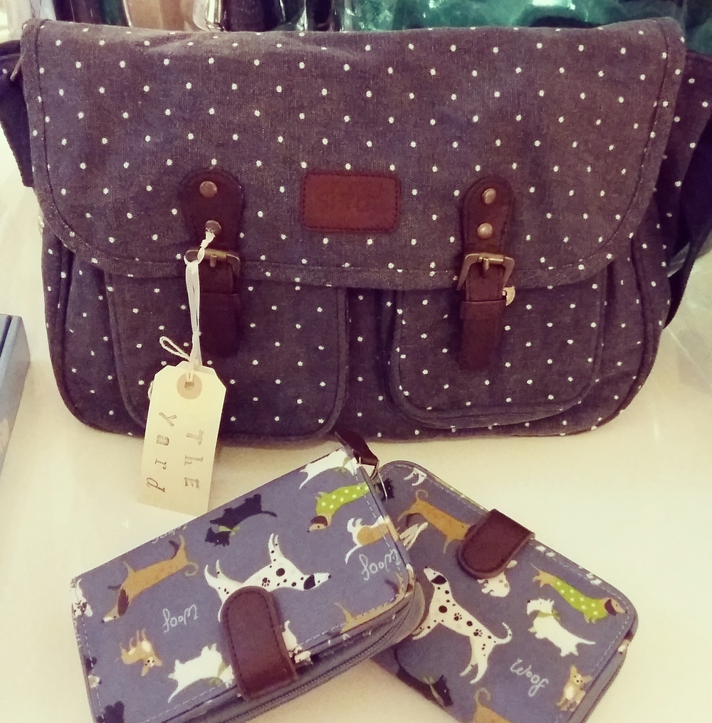 Navy polka dot satchel and dog print oil cloth purses