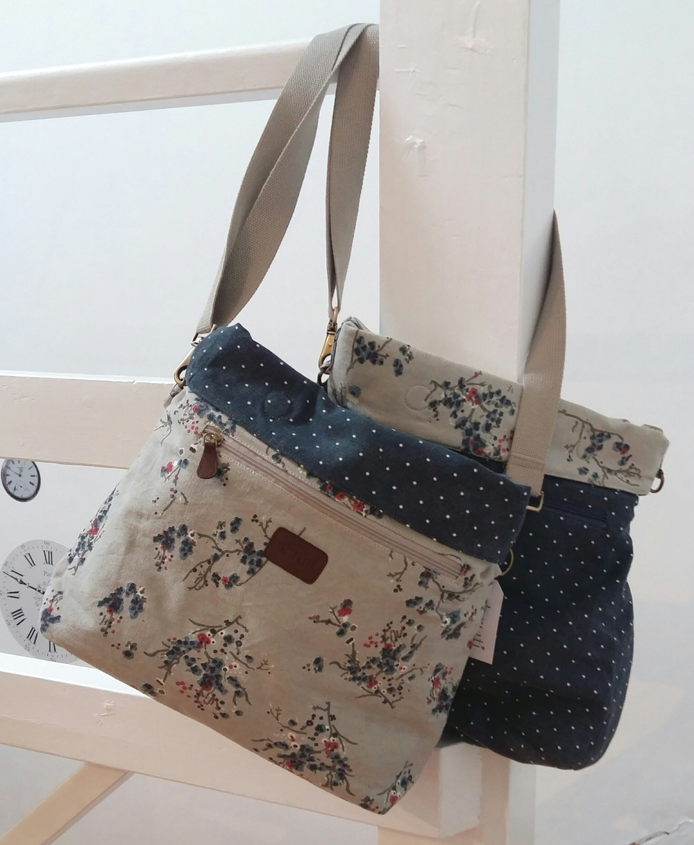 Large reversible floral and spot cross body bag only £27.00