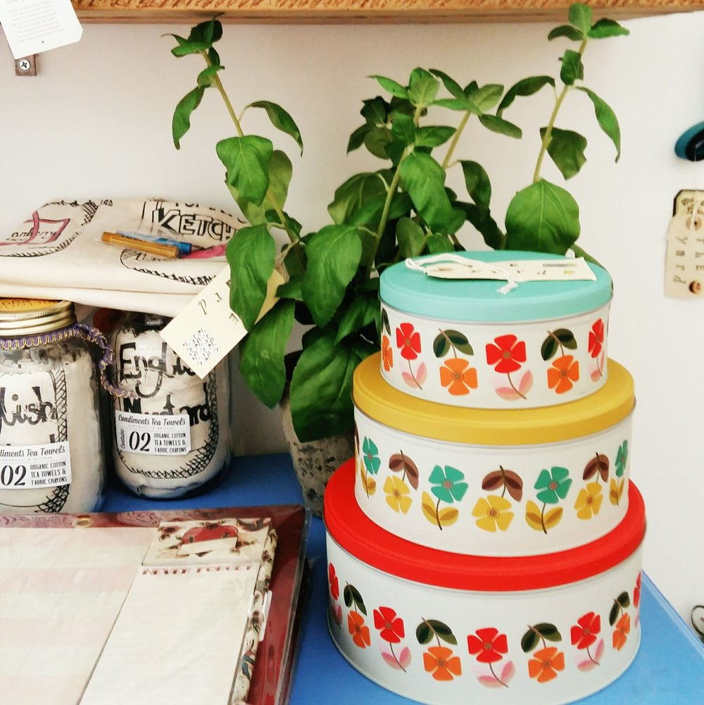Retro cake tins and faux basil plants