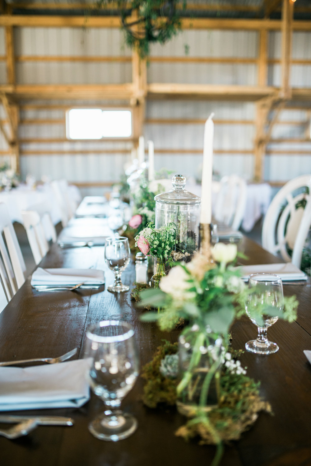 the bee's knees floral design decor minneapolis wedding flowers florist bridal florals brainerd lakes minneapols st paul twin cities st cloud duluth mankato mn florist whimsical florals wedding in the country barn wedding blush and greenery bride bouquet garden inspired loose flowing silk and willow ribbon tablescape table centerpiece moss blush flowers