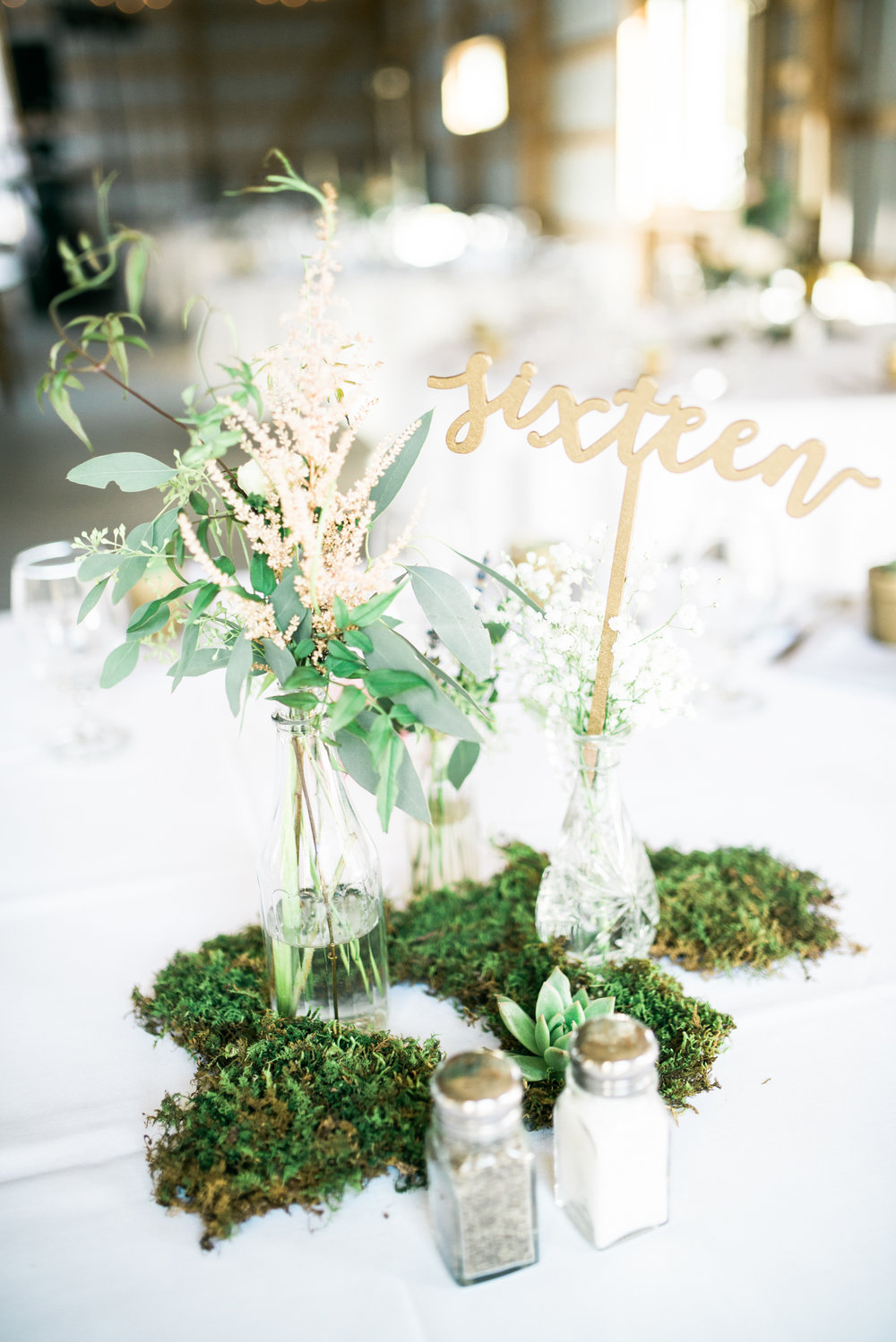 the bee's knees floral design decor minneapolis wedding flowers florist bridal florals brainerd lakes minneapols st paul twin cities st cloud duluth mankato mn florist whimsical florals wedding in the country barn wedding blush and greenery bride bouquet garden inspired loose flowing silk and willow ribbon tablescape table centerpiece moss blush flowers outdoor wedding archway