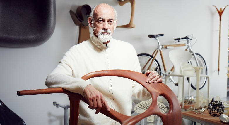 Ross Lovegrove at his studio in London with a prototype of his Anne chair for Bernhardt Design.