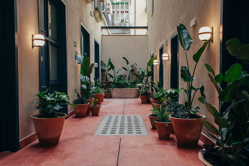 Plants in original marble tubs line the courtyard.