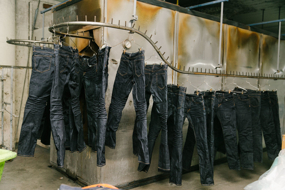 "After wet processing, the jeans are dried and prepped for the final detailing. ""We want them to look authentic,"" Fry says. We work really hard to make the washes and fabric not look contrived."" (Photo: Angi Welsch/Surface)"