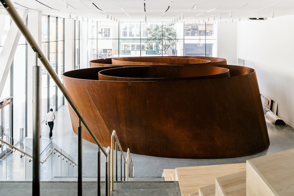 Interior of the new Snøhetta-designed SFMOMA extension and a Richard Serra installation. (Photo: Justin Kaneps/Surface)