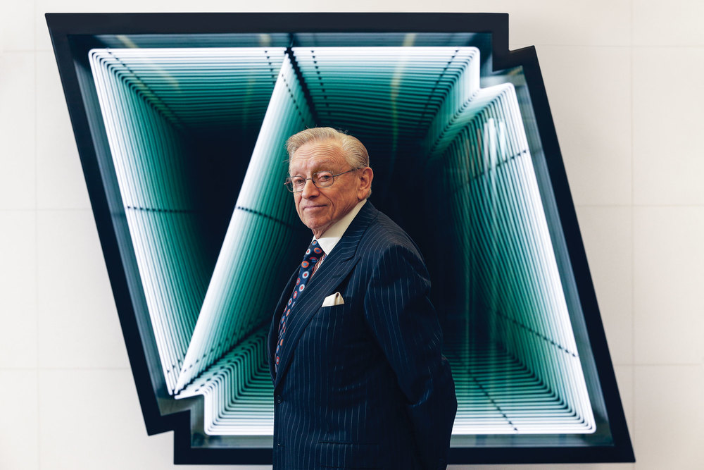 Larry Silverstein at 4 World Trade Center in front of a work by artist Iván Navarro. (Photo: Ogata/Surface)