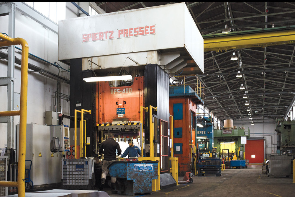 A 20-foot-tall press can apply up to 650 tons of pressure to shape individual steel oven panels. (Photo: Monika Hoefler/Surface)