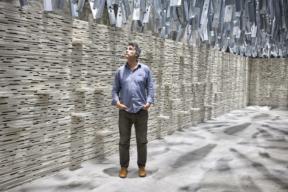 Alejandro Aravena in his exhibit at the Arsenale, created using waste material generated from the last Venice Biennale. (Photo: James Mollison/Surface)