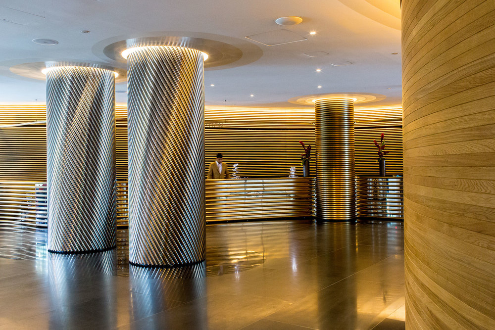 Stainless steel pillars in the lobby of the Watergate Hotel. (Photo: Justin Tsucalas/Surface)