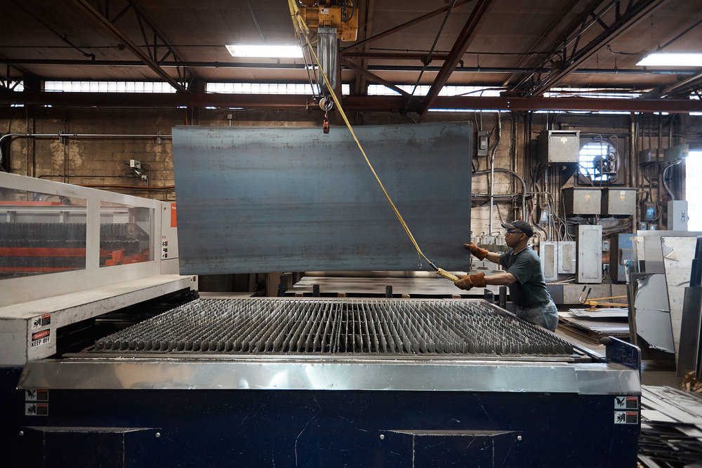 Most panels start as 5-by-10-foot sheets of stainless steel that are then placed on a laser-cutting machine.