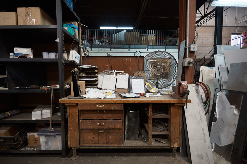 An individual workspace in the factory, where most things are still done as a joint effort between man and machine.