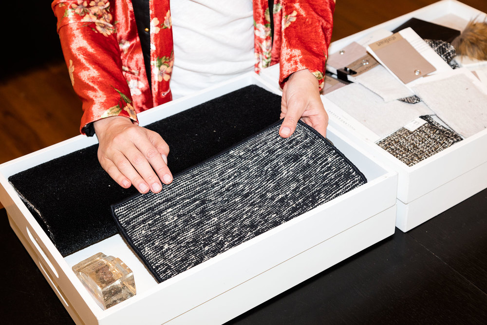 Mann handles fabric swatches at her New York office. (Photo: Nicholas Calcott/Surface)