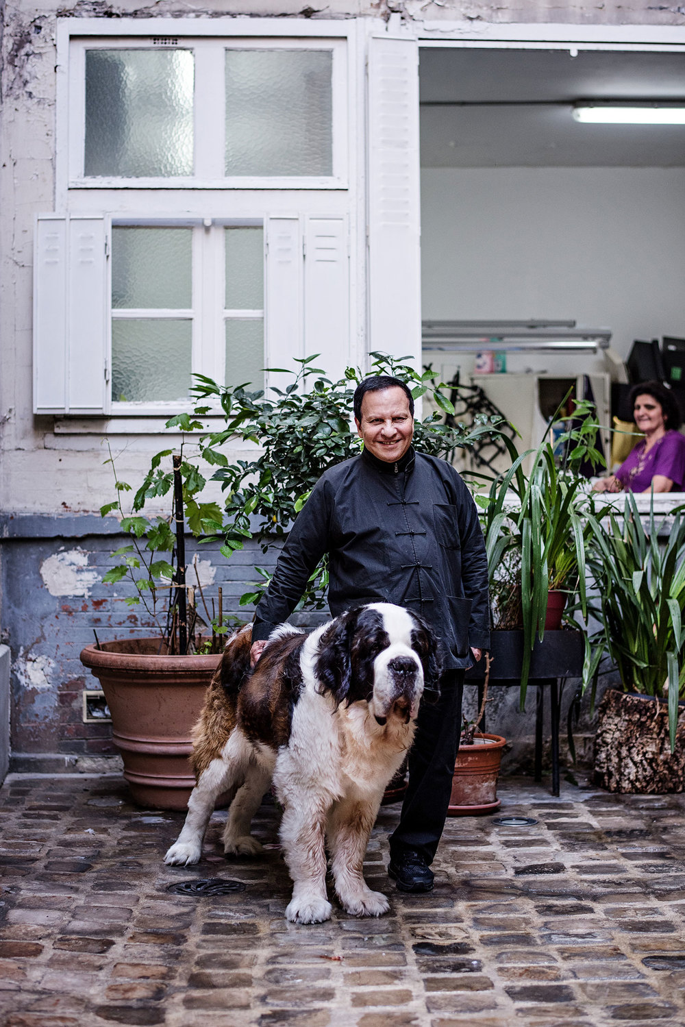 Alaïa and his St. Bernard, Didine, in Paris. (Photo: Franck Juery/Surface)