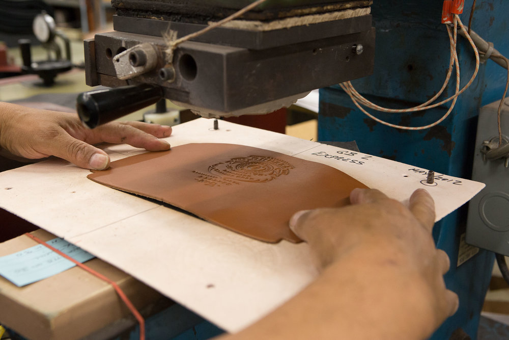 The leather-stamping process.