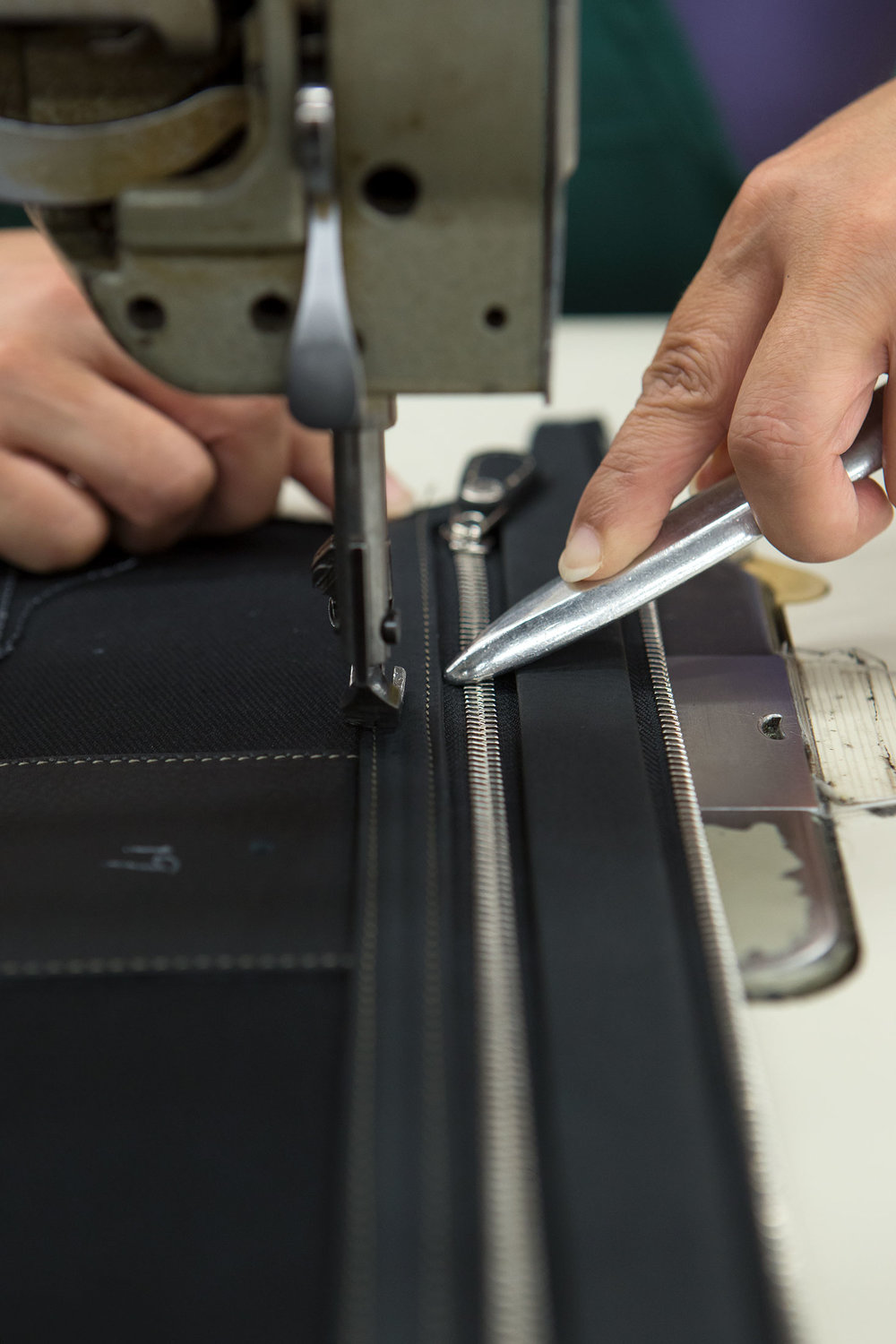 Sewing on a zipper.