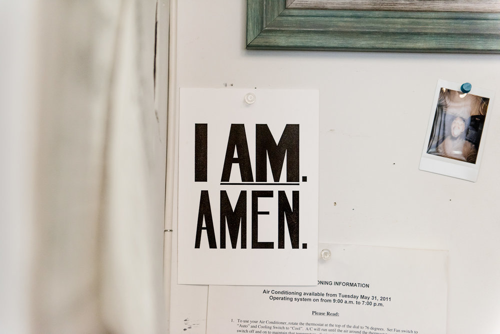 "An ""I Am Amen"" postcard inspired by a sign used by black sanitation workers during a 1968 strike. Thomas created a series of paintings, titled ""I Am A Man,"" based on these posters in 2009."