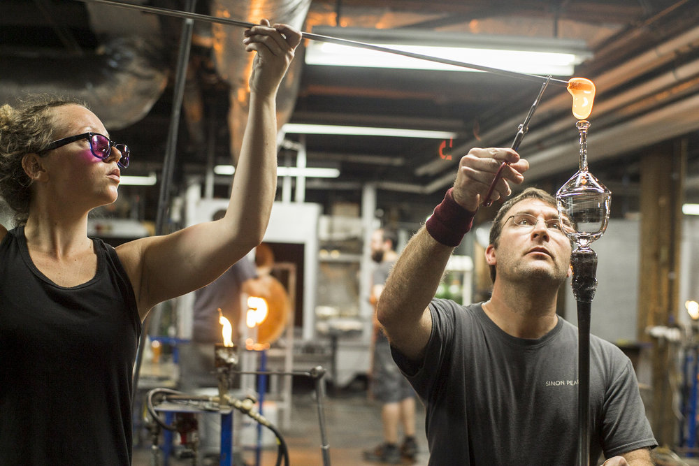 Scenes at Simon Pearce's glassblowing workshop.