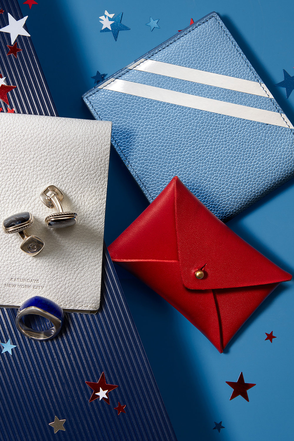 (CLOCKWISE FROM LEFT) Wallets,  Saturdays NYC ,  Thom Browne , and  J.W. Hulme Co.  Ring and cufflinks,  David Yurman .