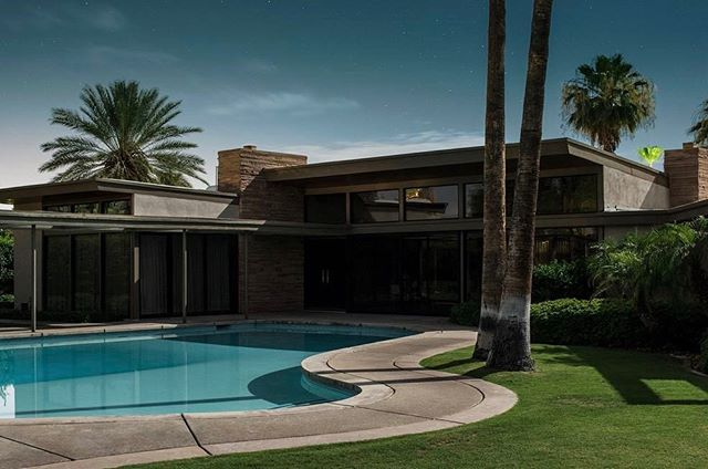 Tom Blachford captures Palm Springs by moonlight in #MidnightModern, a new hardcover from @powerhousebooks. 🌴🌴 The Frank Sinatra Twin Palms Estate is one shot from the cinematic series. #surfacemag