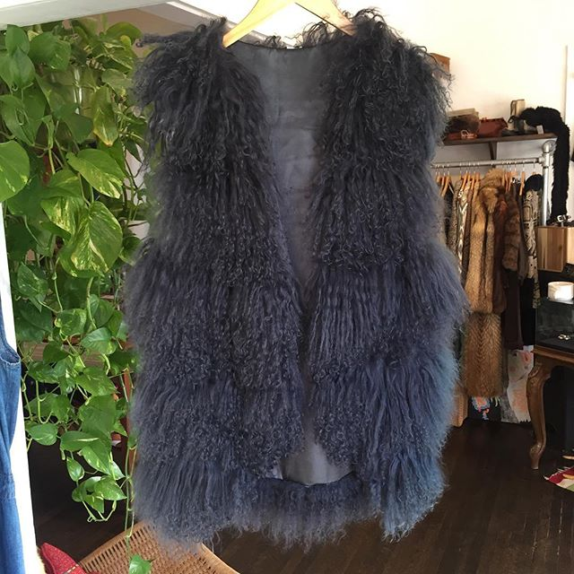 Dead over this Mongolian lamb vest in stormy gray! Long and loose cut with hook  closure. $150