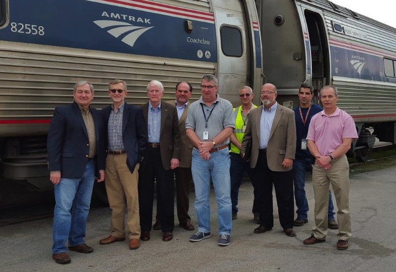 John Spain, left, John Robert Smith, Dick Hall, Knox Ross, Joe McHugh, an Amtrak employee, Greg White, a second Amtrak employee and Bill Hollister pose outside an Amtrak train during the trip. John Spain, Knox Ross and Greg White are members of the Southern Rail Commission's executive committee, Dick Hall is the Mississippi Central District Transportation Commissioner, and Joe McHugh and Bill Hollister are with Amtrak.