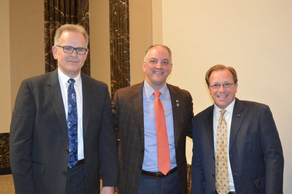 Louisiana Governor John Bel Edwards (center) with Amtrak's Vice President, Long Distance Services Business DevelopmentMark Murphy (left) and Director of Government Affairs-South Todd Stennis (right)