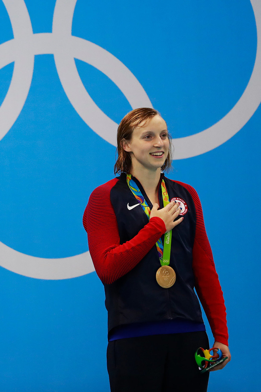 USA swimmer Katie Ledecky stands proudly with her Rio Olympic Gold Medal.