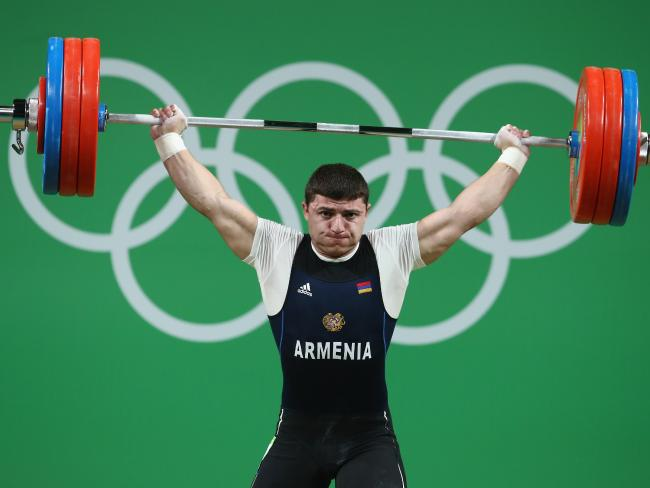 Armenia's Andranik Karapetyan attempting to lift 195kg in the 77kg competition.