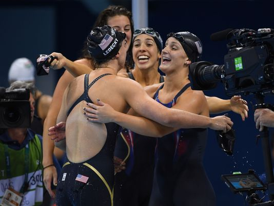 USA team winning gold in the women's 4x200 freestyle.
