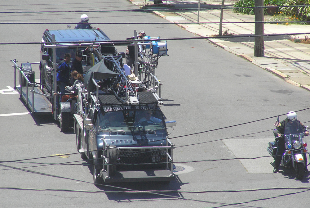 Film crew  sets up a chase scene around our block.