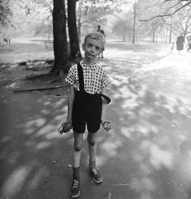 "Above: ""Child with Toy Hand Grenade in Central Park"" (1962) by Diane Arbus. In 2005 an original print of the photograph sold for $408,000."