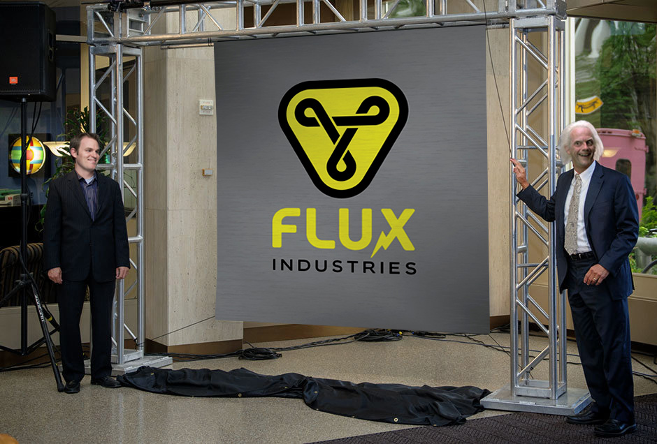 Designer Dave Barton (left) and CEO Emmett Brown (right) unveil the new logo.