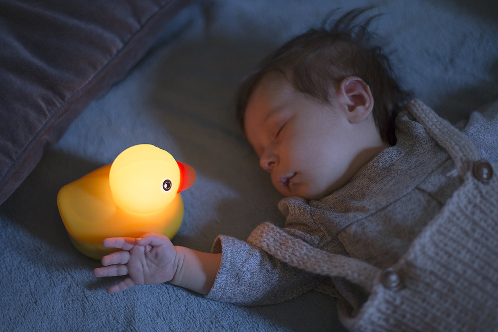 Soft night light and soothing sleep sounds comfort baby.