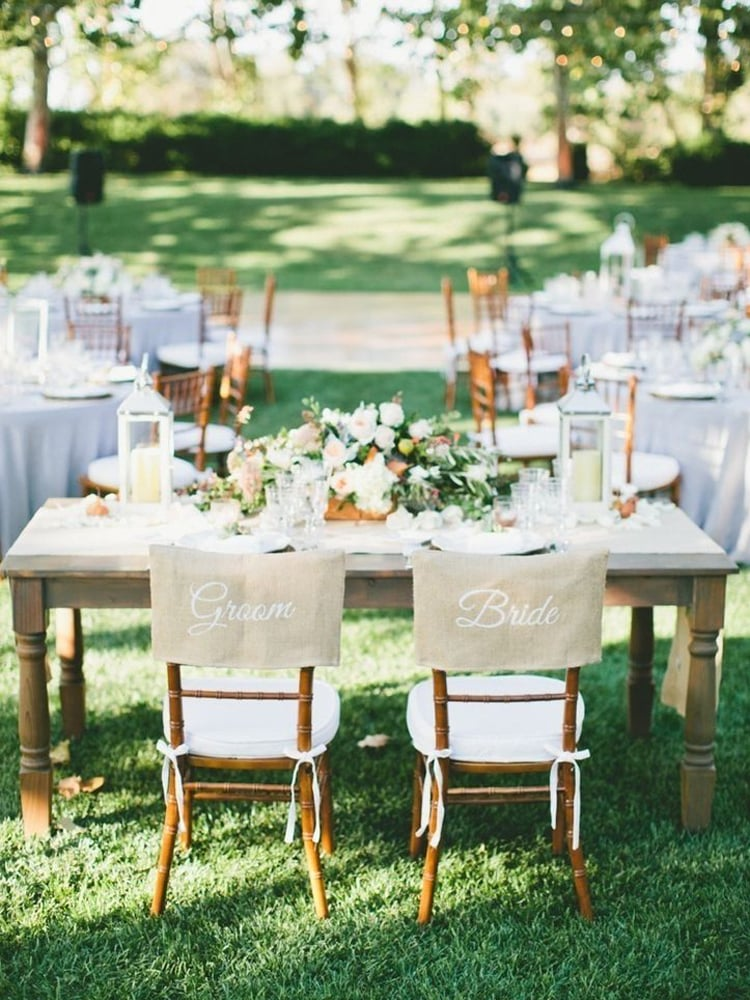2015-wedding-trends-decor-rustic-chair-caps.jpg