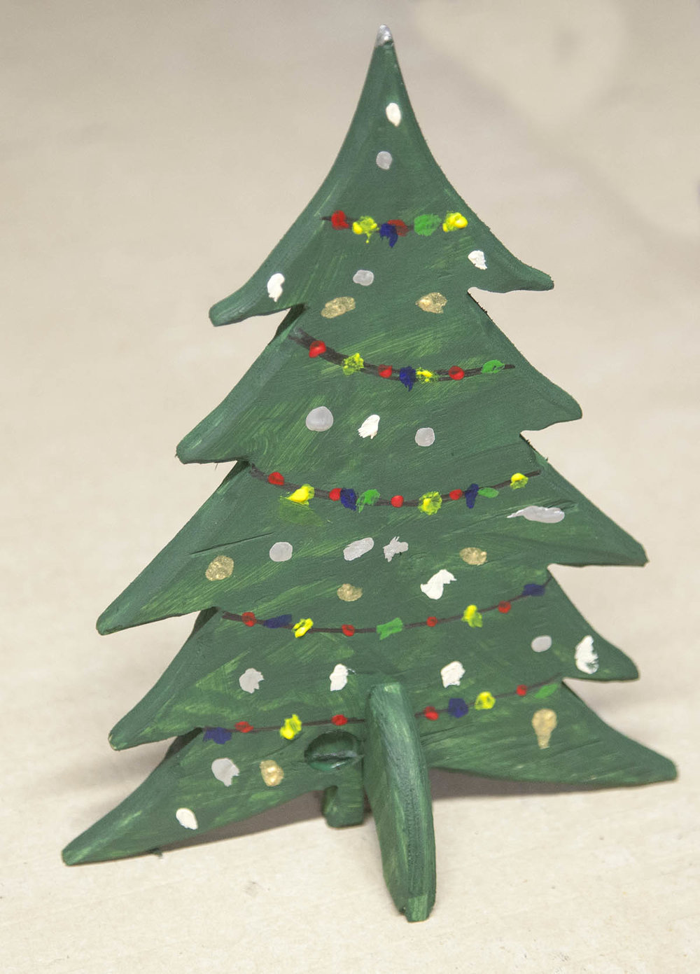 the simple christmas tree project is born its a simple tree cut out of a 9 x 11 x 12 piece of scrap plywood