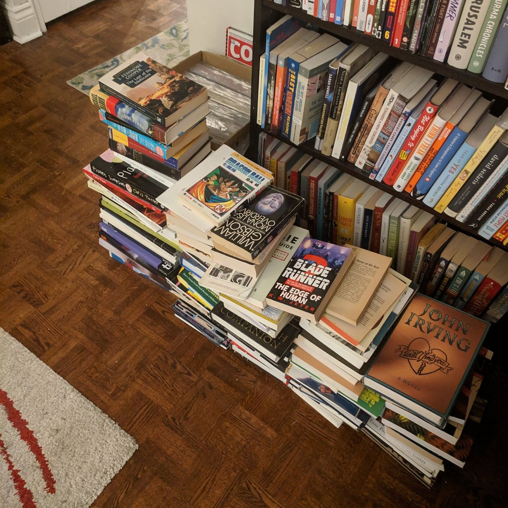 Over 100 books y'all, BYE! Except not actually bye because it's hard to take over 100 books to the used bookstore when you can't walk very far. Hahaha.