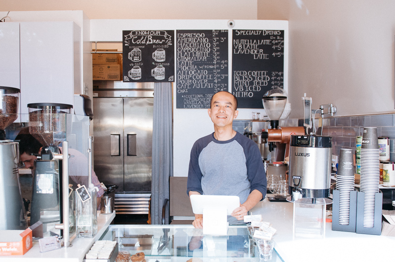 Photos by Natalie Whearley. Bliss Coffee co-owner, Jimmy Huang, behind the register.