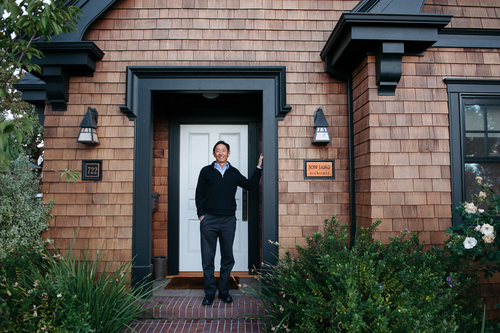 Photos by  Natalie Whearley . Jon Jang in front of his home/studio in downtown Redwood City.
