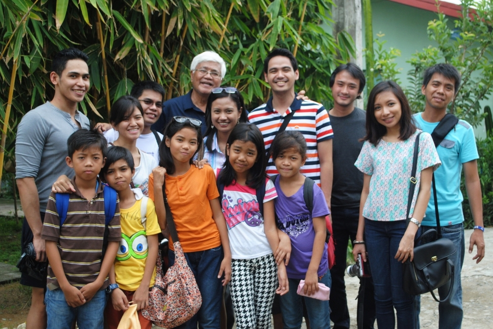 From the left: Ronald, Suzie, Ariz, GK founder Tito Tony Meloto, Abby, Jethro, yours truly, Via, and Michael with the kids from the GK community. Special thanks to Ronald and Abby for co-founding the Thousand Books Project. You can visit their  Facebook page  for more updates on their project and for more on how you can help their cause.