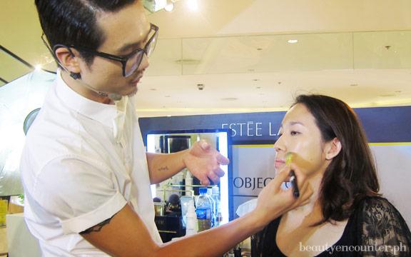 Bobby applies base makeup on his model, fashion designer Mariane Perez.
