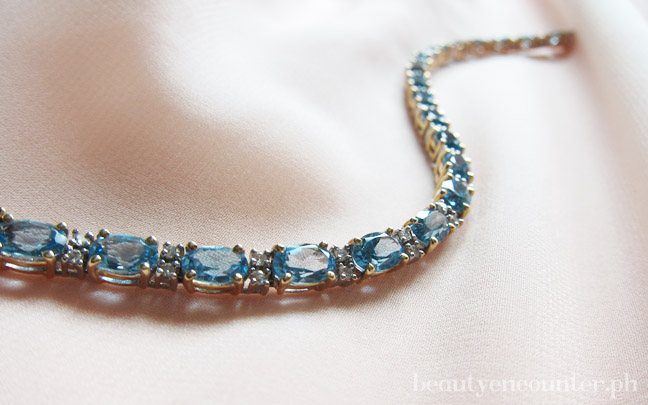 Something borrowed: My mom's aquamarine bracelet lent to me for a wedding I attended. Aquamarine is her birthstone.
