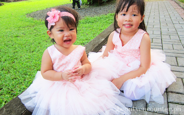 Here's Vera with her favorite Atsi Lara and fellow flower girl. They're sitting because they both sort of fell over from gigil-ing each other.