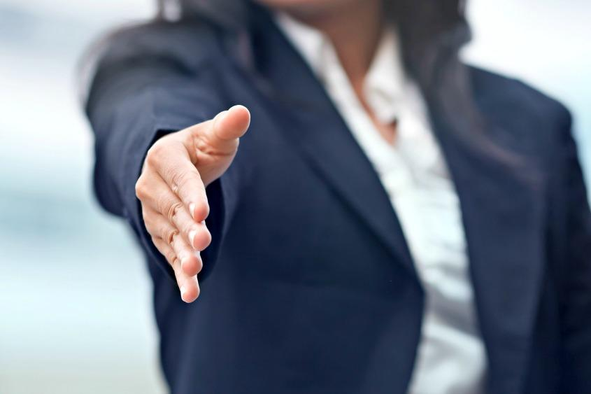 woman reaching out to shake hand.jpg